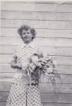 Verna Lund with a bridal bouquet that she had made when she was working at the flower shop in Red Deer